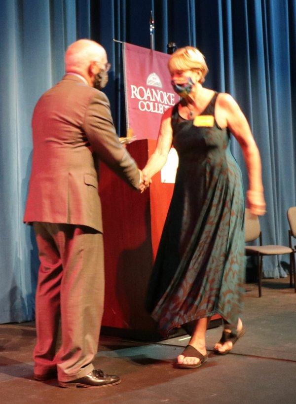 Roanoke president Mike Maxey congratulates SML Arts Council's Karen DeBoard.jpg